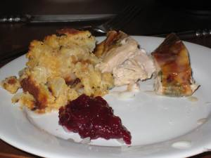 herb-roasted turkey breast, cornbread dressing, home-made cranberry-orange sauce
