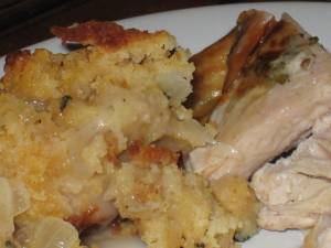 cornbread stuffing with bacon and caramelized onions, served w/ herb-rosted turkey breast